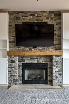 diy stone fireplace with wood mantel