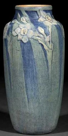 pottery & porcelain, Louisiana, A 1919 Newcomb College art pottery matte glaze vase decorated by Henrietta Bailey with a relief-carved motif...