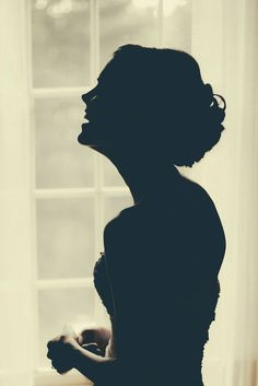 Beautiful silhouette photo of the bride! Photo by: Red Sparrow Studio