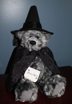 SHE IS MADE OF BLACK AND GRAY MOHAIR,GRAY SUEDE PADS AND FULLY JOINTED. SHE IS STUFFED WITH EXCELSIOR, POLYESTER, GLASS BEADS AND STEEL SHOT. SHE WEARS A BLACK CAPE AND HAT. | eBay!