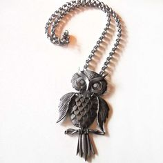 I'm pretty sure Nana has this!! @Jen Ackroyd ('70s Owl Pendant Necklace)