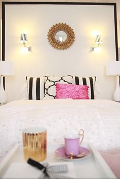 Love the white bedding with classy black white pillows with an accent color!!