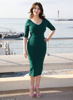 Making them green with envy: Nigella Lawson ensured her famed figure was on full display as she made an appearance at MIPCOM - an annual television trade show held in Cannes, France - on Monday afternoon #Diva #DivaCatwalk #NatalieDress #MatureModels