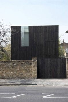Sunken House by Adjaye Assocates in northeast London. The timber used to clad the exterior has been stained a rich, dark brown and hemp was used to insulate the walls. _