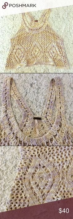 FREE PEOPLE CROCHETED TANK TOP SZ M EUC Gorgeous Free People crocheted tank top in a size medium & is in excellent condition. Taking offers on individual items & bundles. Thank you.:) Free People Tops Tank Tops