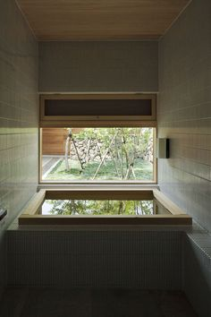 The Art of the Japanese Bath | House in Ichihara  by Yasushi Horibe Architect & Associates.  This very compact bathroom is lined in thin tiles. The small, yet deep, wooden bath looks into a small courtyard.