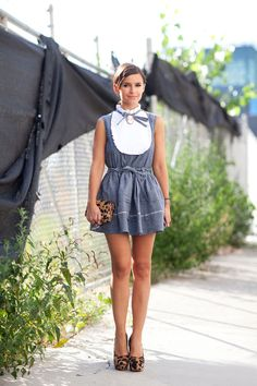 STREET STYLE SPRING 2013 - Miroslava Duma accessorizes her denim dress with leopard print and a cameo.