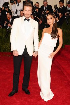 David and Victoria Beckham. Met Gala on May 5, 2014. Victoria wore her namesake label while David donned a Ralph Lauren Black Label tuxedo.