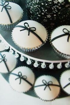 Black and White Baby Shower Cupcakes with Silver or Pearl Bead Non Pareil: All black and white baby shower cakes and cupcakes are not as minimalist by design as the ones in the above pictures.  Elaborate layered cakes with fondant