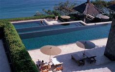 The world's best hotel pools -   Amankila, Bali -   A three-tiered pool with sweeping ocean views greets visitors at this secluded resort, lying in the shadow of Mount Agung.