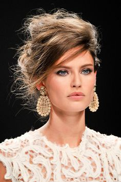 Messy up-do, perfect make-up and those earrings - Gorgeous!