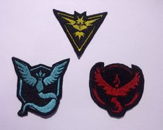 These patches are of the Team Insignias from the Pokemon series, Team Mystic, Team Valor, and Team Instinct. They are approximately 2x2 inches. This listing is for a single patch, be sure to choose the one you would like in the Item options.  These patches go great on clothing, bags, laptop cases, backpacks, hats, and more.  This Patch includes Iron on backing. To Iron onto fabric: Position patch on fabric. With iron at wool setting, use a damp press cloth and press firmly for 10-15 seconds…
