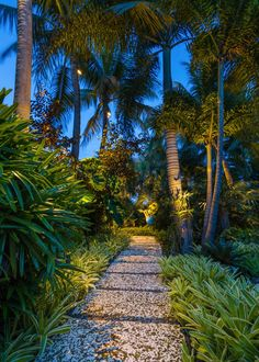 HGTV presents a water garden with a tiki hut, a koi pond, an attractive water feature, and a bridge and walkway made with oolite and coral stone.