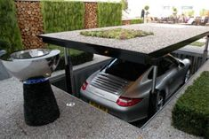 This is an example of overhead horizontal element that define space. This mechanically driven garage, when raise, would indicate the car's territory.