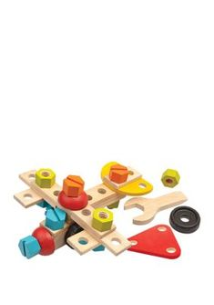Plan Toys Construction Set. This 40-piece wooden Construction Set introduces basic construction skills and includes wooden bolts, screws, a 2-in-1 wrench/screwdriver, and wheels for hours of imaginative play. The pieces can easily be assembled and rearranged to create a host of different vehicles and wooden models, or virtually any form imaginable! Children develop creativity, coordination, fine motor skills, and logic while playing. Like all Plan Toys products, this set is created with… Woodworking Classes, Woodworking Wood, Revell Model Cars, Woodworking Nightstand, Plan Toys, Model Cars Kits, Wood Working For Beginners, Imaginative Play, Fine Motor Skills
