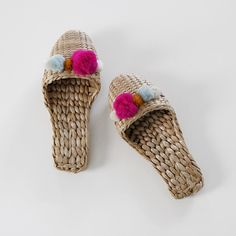 One of a kind hand braided straw house slippers adorned with soft multicolored pom poms. Please note that these are meant to be worn indoors only. Due to the handmade nature of this item, item purchas