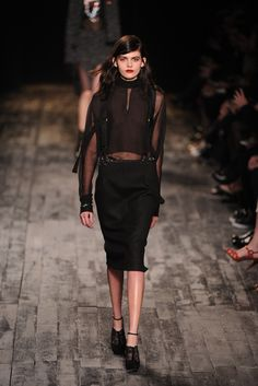 Nina Ricci --- I dig the pencil skirt with suspender look.