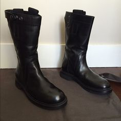 Rick Owens Black Biker Boots Black leather biker boots from Rick Owens featuring pull tabs at the sides, a press stud, round toe and a ridged rubber sole. Never been worn. No trades. Open to offers and bundling. Rick Owens Shoes Combat & Moto Boots