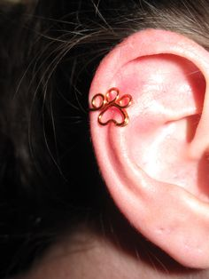Wire Wrapped Paw Print Ear Cuff MADE TO ORDER by 1ofAkinds on Etsy, $5.00 (wonder if I could hand make them)