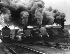 London and North Eastern Railway (LNER) streamlined locomotives during a performance test in London. From left, Dominion of New Zealand, Golden Shuttle, Empire of India, Golden Eagle and No. (Photo by Harry Todd/Fox Photos/Getty Images). Steam Trains Uk, Old Steam Train, Lee Friedlander, Diesel Locomotive, Steam Locomotive, Train Car, Train Tracks, Diorama, Steam Railway