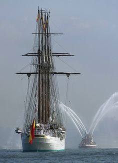 The tall ship from Spain, Elcano, is saluted by the fire boat as she sails up the Hudson River. Credit: Floyd Frisch.