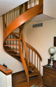 Wooden spiral staircase that leads to master suite.