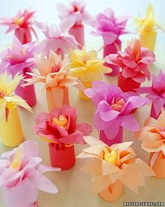 Wrap favors in brightly colored tissue paper and top them off with a paper flower -- a low-cost alternative to the real thing.