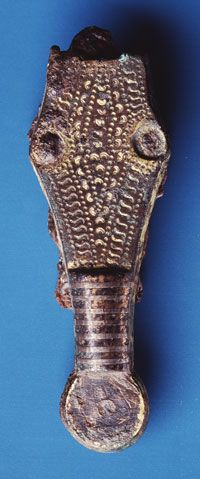 Strap end from a warrior's grave found in Torgård, ca. 600 A.D.