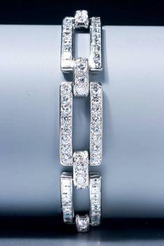 HENRI LAVABRE FOR CARTIER An Art Deco diamond bracelet, composed of four rectangular early modern brilliant cut links and four rectangular step cut diamond links, with diamond connectors, mounted in platinum. Bijoux Art Deco, Art Deco Jewelry, Modern Jewelry, Vintage Jewelry, Fine Jewelry, Jewelry Tree, Antique Jewelry, Jewelry Design, Diamond Bracelets