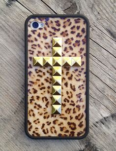 Leopard print and gold studs in a cross formation, hand-crafted onto a durable, matte black iPhone 4/4s rubber bumper. This design will be available for the iPhone 5 case.
