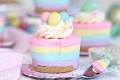 Easter No-Bake Mini Cheesecakes are cute, pastel-striped cheesecakes. They're an easy Easter dessert with no baking required!