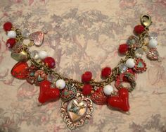 Heart Charm Bracelet .. Lots of hearts in this bracelet (some are from B'sue) I used Alcohol Inks and Gilders Paste on the hearts and used a mixture of colored glass beads .. chain is brass .. https://www.facebook.com/#!/JewelsByJann