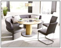 Grey Upholstered Curved Bench With Round Table And Chair Placed On Wooden Floor Kitchen Seating Dining Room