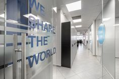 Office architectural & interior design realised by STIRIXIS Group for the renovation of Marine Tours SA. Environmental graphics with the brand identity and inspirational quotes are used for a transparent and vivid result. Strategic Goals, Strategic Planning, Office Interior Design, Office Interiors, White Office Furniture, Glass Partition, Travel Organization, Environmental Graphics, Brand Identity