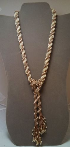 This necklace is woven together using the double and single spiral rope weave. Using Copper Lined Alabaster and Cream seed beads. Two looks