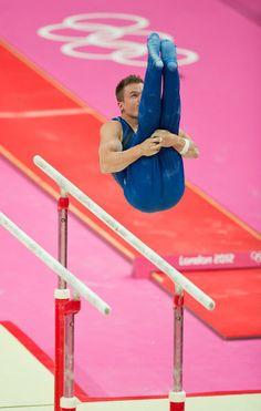 Jonathan Horton dismounts the parallel bars during Team USA men's gymnastics' qualifications at the London Olympics. Gymnastics History, Boys Gymnastics, Gymnastics Equipment, Elite Gymnastics, Artistic Gymnastics, Male Gymnast, 2012 Summer Olympics, Athletic Men, Team Usa