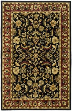 Create a vibrant feeling with a rug from Safavieh's Heritage Collection. These very detailed rugs are hand-tufted of pure wool with a strong cotton backing.They are beautifully made and will withstand high traffic areas in your home.This item has...