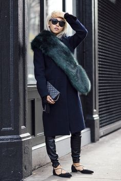 Vanessa Hong - The Haute Pursuit // bleached blonde bob, oversized sunglasses, green fur scarf, navy coat, Chanel bag, leather pants, and lace-up flats #style #fashion
