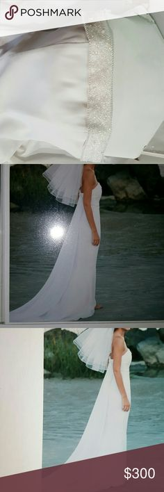 St. Tropez wedding dress (David's Bridal) Simple, white, Holter top style dress with pearl and crystalline band at the top of the dress that wraps around to the back.  And also a matching headband and veil. Size 4 has been altered fits more like a 0 St. Tropez Dresses Wedding