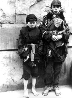 Warsaw, Poland, Two barefooted children dressed in rags in a ghetto street.