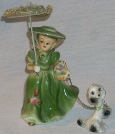 I had one of a little girl in blue with a poodle on a leash Vintage Antiques, Vintage Items, Cow Creamer, Under My Umbrella, Collectible Figurines, China Porcelain, Porcelain Doll, Vintage China, Vintage Ceramic