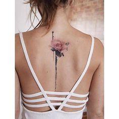 Pink rose tattoo on the upper back. Tattoo Artist: Fernando #upperbacktattoos