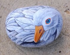 image of a goose painted on a rock..