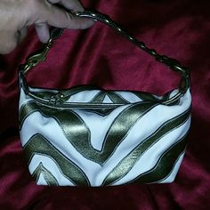 Coach Gold Zebra Strip Purse Pouch RARE! This is a hard to find Coach #478 gold stripe purse pouch. Only used a couple times and in excellent condition .this item could pass for new. Coach Bags