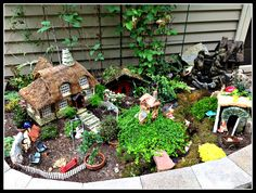 I am proud to show you the delightful creation of a customer of mine. She has a way with design and the miniature green roof is awesome!