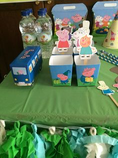 Peppa's water bottle with treat boxes and a bus decoration with all her friends