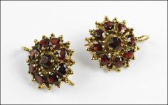 A PAIR OF GARNET AND 14 KARAT YELLOW GOLD WIREBACK EARRINGS. Lot 150-7038 #jewelry