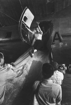 LIFE Goes to Stewardess School, 1958   Caption from LIFE. Emergency exit from plane is practiced by Louise Becker who leaps down canvas slide at Fort Worth's airport. Slide is dusted with chalk to make it slippery. Louise made perfect seat-first landing