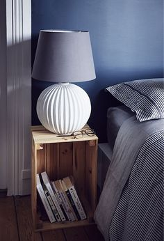 Try using an upturned crate as a bedside table - there's room for a lamp and storage below for books. Find ideas from homes around the world at IKEA.com #IKEAIDEAS