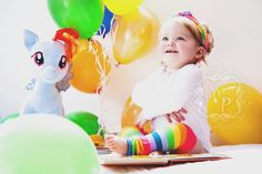 © Sara Callow Photography cute toddler baby girl rainbows lifestyle photography natural light at babes home  balloons my little pony